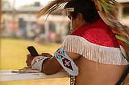 Crow Fair, Crow Indian Reservation, Montana, powwow dancer, mobile phone