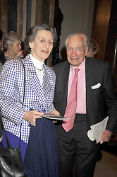 SIR MARTIN & LADY JACOMB at a private view of the Kuniyoshi exhibition at the Royal Academy, Piccadilly, London on 17th March 2009.