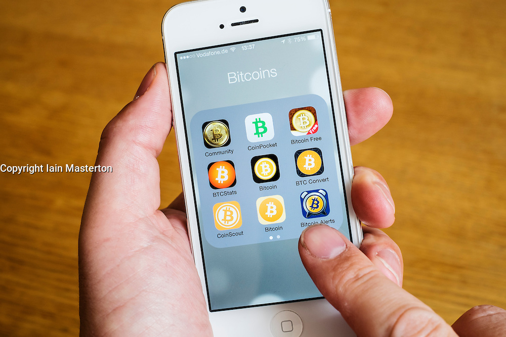 Detail of many Bitcoin apps on iPhone smart phone