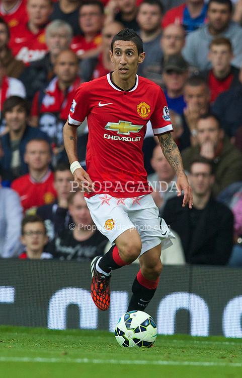 MANCHESTER, ENGLAND - Sunday, September 14, 2014: Manchester United's Angel Di Maria in action against Queens Park Rangers during the Premier League match at Old Trafford. (Pic by David Rawcliffe/Propaganda)