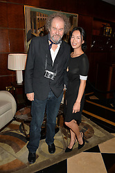 MIKE FIGGIS and ROSEY CHAN at the London launch of Casamigos Tequila hosted by Rande Gerber, George Clooney & Michael Meldman and to celebrate Cindy Crawford's new book 'Becoming' held at The Beaumont Hotel, Brown Hart Gardens, 8 Balderton Street, London on 1st October 2015.
