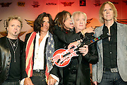 In this photo released by Hard Rock, Aerosmith's Joey Kramer, Joe Perry, Steven Tyler, Brad Whitford and Tom Hamilton, left to right, launch their first video game, 'Guitar Hero: Aerosmith,' Friday, June 27, 2008, during a press conference at Hard Rock Cafe in New York.  (AP Photo/Diane Bondareff, Hard Rock)