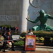 Metro Detroiters celebrate the 50th Anniversary of the restored Spirit of Detroit Statue.