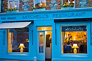 Mitchell's seafood restaurant lit by lamplight, Clifden, Connemara, County Galway, Ireland
