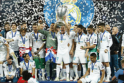 (L-R) Jesus Vallejo of Real Madrid, Daniel Carvajal of Real Madrid, Luka Modric of Real Madrid, Achraf Hakimi of Real Madrid, Sergio Ramos of Real Madrid, goalkeeper Keylor Navas of Real Madrid, Lucas Vazquez of Real Madrid with UEFA Champions League trophy, Coupe des clubs Champions Europeens, Theo Hernandez of Real Madrid, Mateo Kovacic of Real Madrid, Isco of Real Madrid, Dani Ceballos of Real Madrid, Casemiro of Real Madrid, Marco Asensio of Real Madrid during the UEFA Champions League final between Real Madrid and Liverpool on May 26, 2018 at NSC Olimpiyskiy Stadium in Kyiv, Ukraine