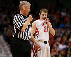 Bridgeport guard Chase Robey (23) talks the game over with a ref during a semi final round game at the Charleston Civic Center.