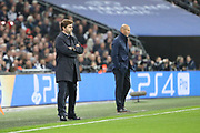 Tottenham Hostpur manager Mauricio Pochettino and Real Madrid manager Zinedine Zidane on the touchline during the Champions League match between Tottenham Hotspur and Real Madrid at Wembley Stadium, London, England on 1 November 2017. Photo by Matthew Redman.