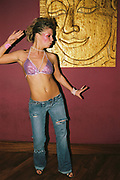 A girl in a bra and jeans dancing, Funktup, December 2004