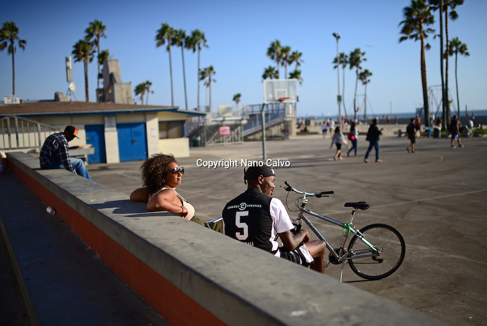 People enjoying a street basketball game, Venice Beach, California.