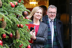 "© Licensed to London News Pictures. 18/12/2018. London, UK. Amber Rudd - Secretary of State for Work and Pensions (L) and David Mundell - Secretary of State for Scotland (R) departs from No 10 Downing Street after attending the weekly Cabinet Meeting that discussed the preparations for a ""No Deal"" Brexit. Photo credit: Dinendra Haria/LNP"