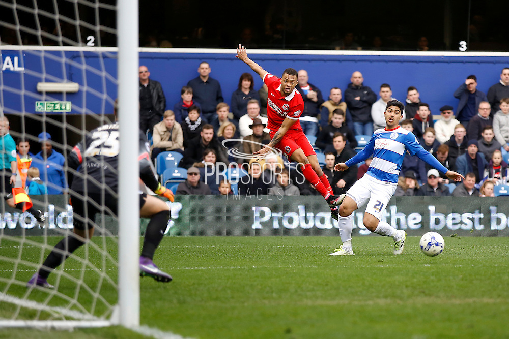 Charlton Athletic midfielder Jordan Cousins (8) drills a low, hard cross into the box during the Sky Bet Championship match between Queens Park Rangers and Charlton Athletic at the Loftus Road Stadium, London, England on 9 April 2016. Photo by Andy Walter.