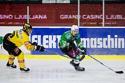 Francois Bouchard vs Eric Pance during 52nd Round of EBEL league ice-hockey match between HDD Tilia Olimpija, Ljubljana and EV Vienna Capitals, on February 7, 2010 in Arena Tivoli, Ljubljana, Slovenia. Vienna defeated Olimpija 8-2. (Photo by Vid Ponikvar / Sportida)