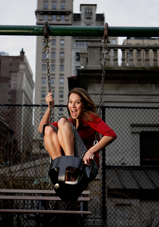 NEW YORK,NY- Actress Erin Fritch enjoys a swing in a Manhattan park March 15, 2007. The actress has appeared most recently as Phyllis in As the World Turns. (Photo by Robert Falcetti)