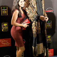 MACAU, CHINA - JUNE 11:  Indian singer Sophie Choudhary poses with Bollywood Ambassador Amitabh Bachchan's waxwork figure at the green carpet during the 2009 International Indian Film Academy Awards at the Venetian Macao-Hotel-Resort on June 11, 2009 in Macau.  Photo by Victor Fraile / studioEAST