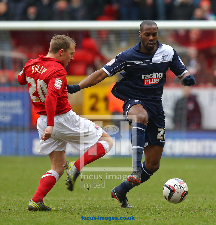 Picture by John  Rainford/Focus Images Ltd +44 7506 538356.16/03/2013.Chris Solly of Charlton Athletic challenges Dany N'Guessan of Millwall during the npower Championship match at The Valley, London.