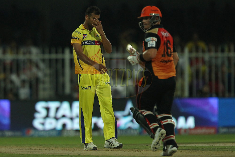 Ishwar Pandey of The Chennai Superkings reacts after a delivery during match 17 of the Pepsi Indian Premier League 2014 between the Sunrisers Hyderabad and the Chennai Superkings held at the Sharjah Cricket Stadium, Sharjah, United Arab Emirates on the 27th April 2014<br /> <br /> Photo by Ron Gaunt / IPL / SPORTZPICS