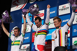 Mark Cavendish (c) of Great Britain stands with Matthew Goss (l) of Australia and Andre Greipel (r) after winning the Men's Eilte Road Race at the UCI Road World Championships on September 25, 2011 in Copenhagen, Denmark. (Photo by Marjan Kelner / Sportida Photo Agency)