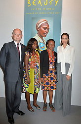 Image ©Licensed to i-Images Picture Agency. 11/06/2014.<br /> <br /> Angelina Jolie (right) and William Hague (left) stop for a photograph with campaigners (2nd left) Nyota Babunga and (3rd left) Carine Safari as they attend the main hall during day 2 of the Global Summit to End Sexual Violence in Conflict at The ExCel, London, UK.<br /> <br /> Wednesday 11th June 2014<br /> Picture by Ben Stevens / i-Images