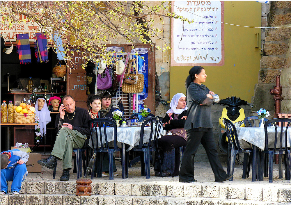 Everybody is looking to the right,  including the dummy heads. The image was recorded in the Druze village of Peki'in, one of the oldest villages in Israel.