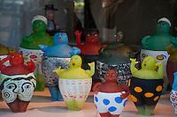 Amsterdam, Holland.  Glass figures seen in a shop window.