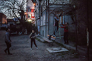 STEPANAKERT, NAGORNO-KARABAKH - APRIL 17: Teenagers play ball behind their house as evening falls on February 21, 2015 in Stepanakert, Nagorno-Karabakh. Since signing a ceasefire in a war with Azerbaijan in 1994, Nagorno-Karabakh has functioned as a de facto part of Armenia, with hostilities along the line of contact between Nagorno-Karabakh and Azerbaijan occasionally flaring up and causing casualties. (Photo by Brendan Hoffman/Getty Images) *** Local Caption ***
