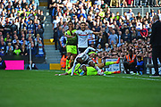 Fulham striker Sone Aluko (24) is tackled by Reading midfielder Daniel (Danny) Williams (23) during the EFL Sky Bet Championship play off first leg match between Fulham and Reading at Craven Cottage, London, England on 13 May 2017. Photo by Jon Bromley.