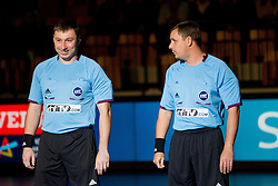 Referees Evgenij Zotin and Nikolaj Volodkov of Russia during handball match between RK Celje Pivovarna Lasko and IK Savehof (SWE) in 3rd Round of Group B of EHF Champions League 2012/13 on October 13, 2012 in Arena Zlatorog, Celje, Slovenia. (Photo By Vid Ponikvar / Sportida)