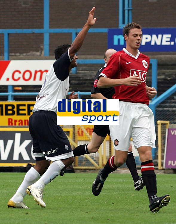 Photo: Paul Thomas.<br /> Preston North End v Manchester United. Pre Season Friendly. 29/07/2006.<br /> <br /> Goal scorer Simon Whaley (L) of Preston celebrates their second goal while Johnny Evans is disappionted.