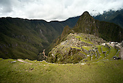 PERU, MACHU PICCHU:  Classic view of Machu Picchu from the Inca terraces with Huayna Picchu in the background and the Urubamba river below. Machu Picchu is a pre-Columbian Inca site located 2,430 metres (8,000 ft) above sea level. It was built around 1460 AD but was abandoned as an official site for the Inca rulers a hundred years later, at the time of the Spanish conquest of the Inca Empire.