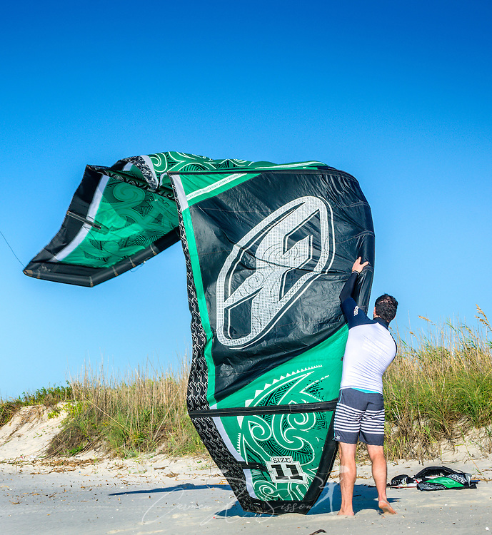 Mathieu Junco prepares to launch his F-One Bandit Six kite, October 18, 2015, in Dauphin Island, Alabama. Junco, from France, began kitesurfing five years ago. Windy conditions on the island brought surfers out in droves, but many, like Junco, found that the brisk northerly winds made kitesurfing challenging on the south side of the island. Kitesurfing began in France in the 1980's and became a mainstream water sport in 1999, combining aspects of wakeboarding, windsurfing, surfing, and paragliding. More than 1.5 million people participate in the global sport. (Photo by Carmen K. Sisson/Cloudybright)