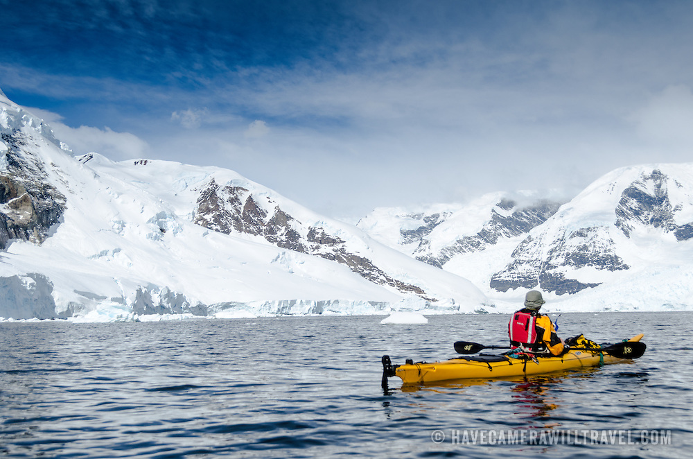 A solo kayakers navigating the waters of Neko Harbour, Antarctica.