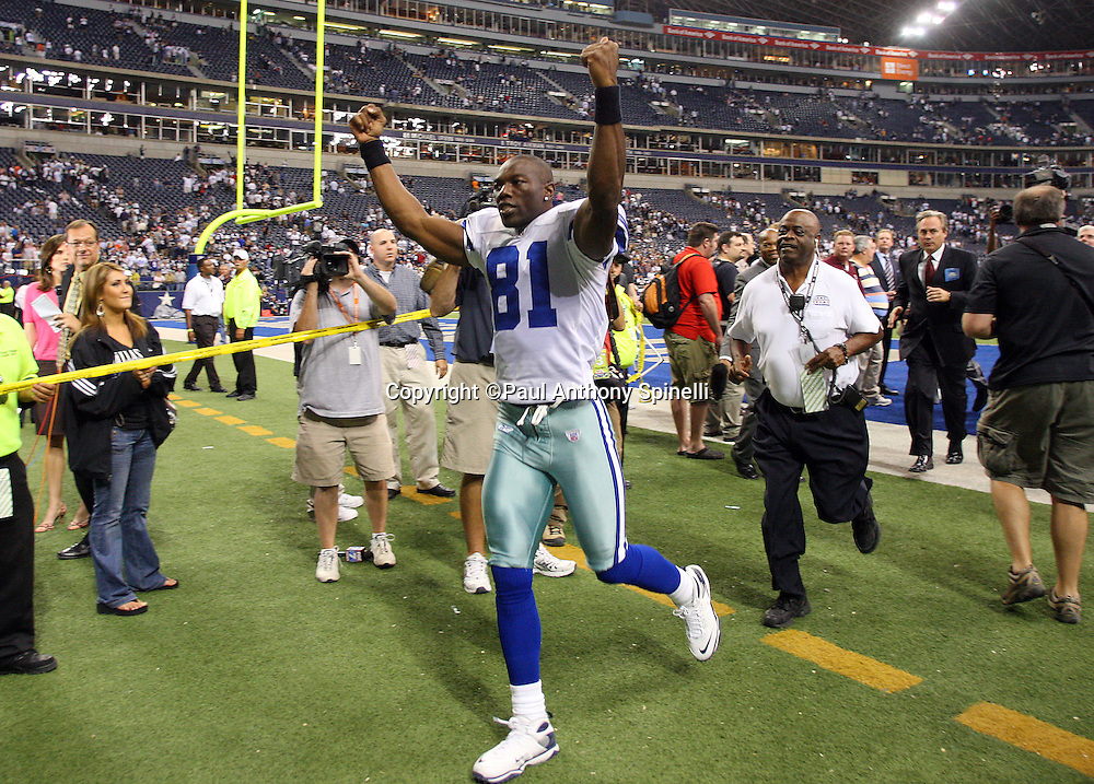IRVING, TX - SEPTEMBER 15:  Wide receiver Terrell Owens #81 of the Dallas Cowboys raises his arms in celebration as he runs off the field after the game against the Philadelphia Eagles at Texas Stadium on September 15, 2008 in Irving, Texas. The Cowboys defeated the Eagles 41-37. ©Paul Anthony Spinelli *** Local Caption *** Terrell Owens