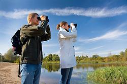 Young Couple Bird Watching. Tartu County, Estonia. Riverside, Binoculars.
