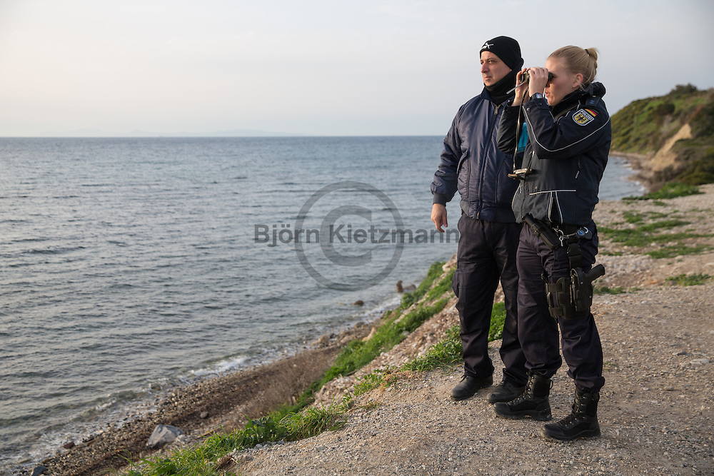 Mytilene, Lesvos, Greece - 08.03.2016      <br /> <br /> German Frontex police officers and their Greek colleagues searching with binoculars for arriving refugee boats on the coast of Lesvos.<br />  <br /> Deutsche Bundespolizisten im Frontex-Einsatz und ihre griechischen Polizei-Kollegen suchen an der Kueste von Lesbos mit Ferngl&auml;sern nach Fluechtlingsbooten.<br /> <br /> Foto: Bjoern Kietzmann