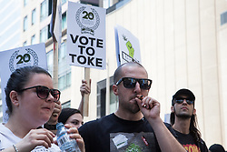 May 5, 2018 - Toronto, Ontario, Canada - 20th Marijuana Global March in Toronto. In this year of 2018,  the Government of Canada will legalize recreational cannabis. In the picture, people smoking cannabis. (Credit Image: © Joao De Franco via ZUMA Wire)