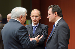 Dominique Strauss-Kahn, managing director of the IMF, left, speaks with Luc Frieden, Luxembourg's finance minister, center, and George Papaconstantinou, Greece's finance minister, during a meeting of the Eurogroup finance ministers at the EU Council headquarters in Brussels, Monday, Dec. 6, 2010. (Photo © Jock Fistick)