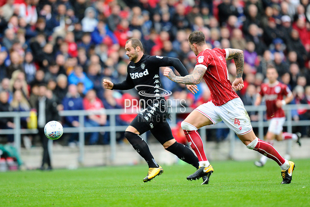Pierre-Michel Lasogga (9) of Leeds United is chased by Aden Flint (4) of Bristol City during the EFL Sky Bet Championship match between Bristol City and Leeds United at Ashton Gate, Bristol, England on 21 October 2017. Photo by Graham Hunt.