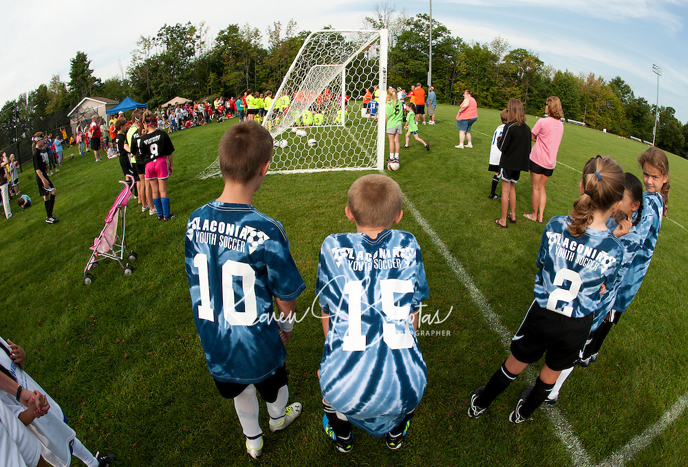 Derek, Derynioski, Dylan Dickey, Victoria Ritchie, Emma O'Neill and Nicole Turpin of the U10 Schumaker Equipment team gather at Robbie Mills Sports Complex Saturday morning for the Laconia Youth Soccer programs opening ceremonies.  (Karen Bobotas/for the Laconia Daily Sun)