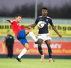 Cowdenbeath's Colin Marshall and Falkirk's Botti Biabi. <br /> Falkirk 1 v 0 Cowdenbeath, William Hill Scottish Cup game played 29/11/2014 at The Falkirk Stadium.