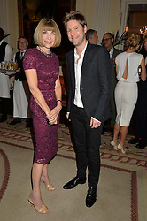 ANNA WINTOUR and CHRISTOPHER BAILEY Chief Creative and chief executive officer of Burberry at a party hosed by the US Ambassador to the UK Matthew Barzun, his wife Brooke Barzun and editor of UK Vogue Alexandra Shulman in association with J Crew to celebrate London Fashion Week held at Winfield House, Regent's Park, London on 16th September 2014.
