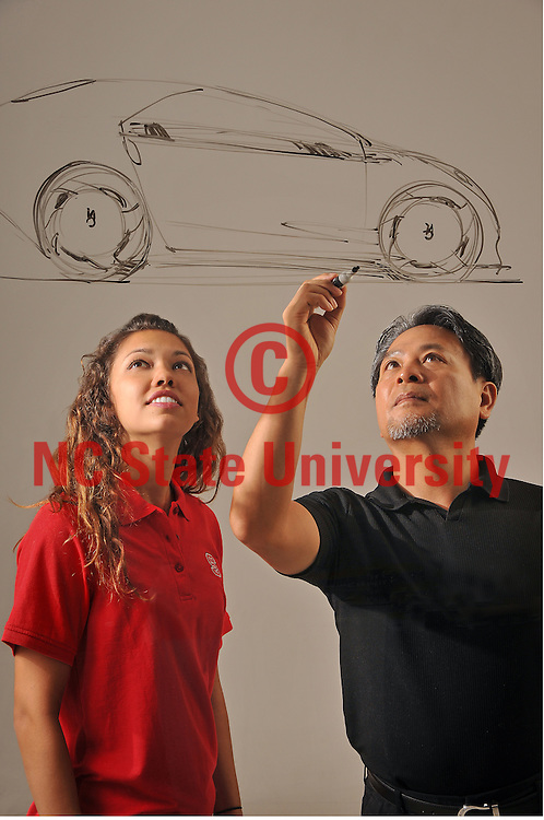 College of Design professor Bong-Il Jin sketches out a car design with student, Shaade Tavares.