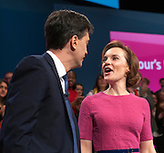 © Licensed to London News Pictures. 23/09/2014. Manchester, UK. Ed Miliband and Justine Miliband on stage after his speech.  Leader of the Labour Party Ed Miliband gives his leaders speech at the Labour Party Conference 2014 at the Manchester Convention Centre today 23 September 2014. Photo credit : Stephen Simpson/LNP