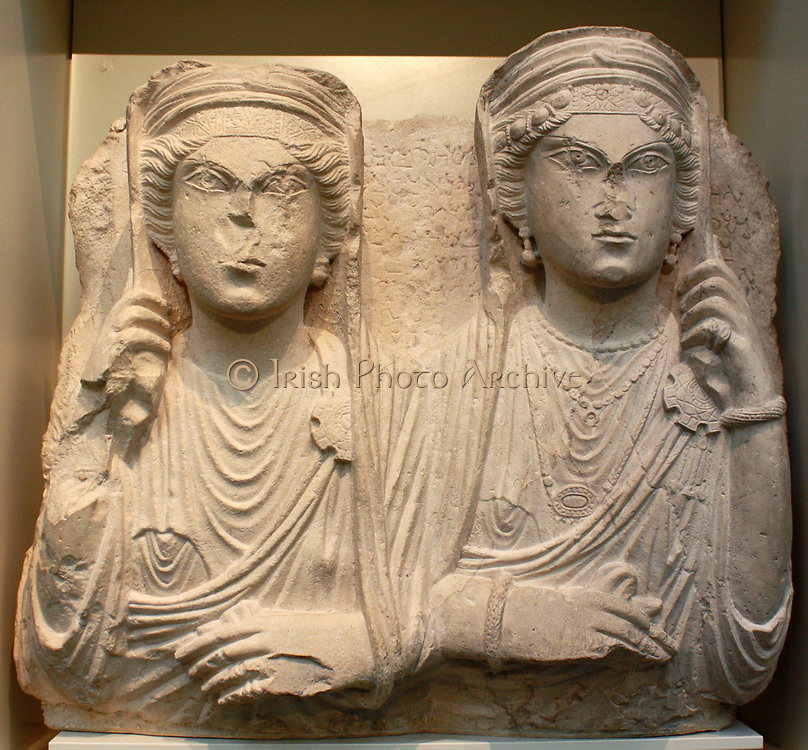 These stone faces, representing Roman Syrians, who lived between about AD 50-270, come from tombs outside the city of Palmyra. Their fashions are Syrian but they are shown in realistic Roman Style. There were three types of tombs, all built for wealthy citizens: single-storey house tombs, towers of several storeys and underground rock-hewn tombs.