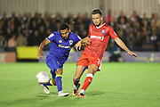 AFC Wimbledon striker Andy Barcham (17) battles for possession with Gillingham defender Luke O'Neill (O Neill) (2) during the EFL Sky Bet League 1 match between AFC Wimbledon and Gillingham at the Cherry Red Records Stadium, Kingston, England on 12 September 2017. Photo by Matthew Redman.