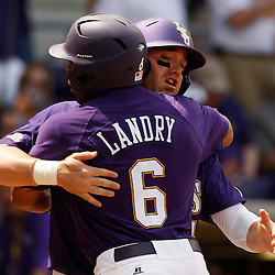 Apr 04, 2010; Baton Rouge, LA, USA; LSU Tigers out fielder Leon Landry (6) celebrates with teammate Matt Gaudet after coming in for a score during a game against the Georgia Bulldogs at Alex Box Stadium. Mandatory Credit: Derick E. Hingle-US PRESSWIRE