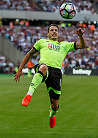 Football - 2016 / 2017 Premier League - West Ham United vs. AFC Bournemouth<br /> <br /> Bournemouth's Adam Smith struggles to kepp the ball in play at The London Stadium.<br /> <br /> COLORSPORT/DANIEL BEARHAM