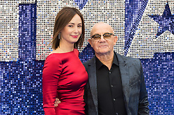 May 20, 2019 - London, England, United Kingdom - Bernie Taupin (R) and Heather Lynn Hodgins Kidd (L) arrive for the UK film premiere of 'Rocketman' at Odeon Luxe, Leicester Square on 20 May, 2019 in London, England. (Credit Image: © Wiktor Szymanowicz/NurPhoto via ZUMA Press)