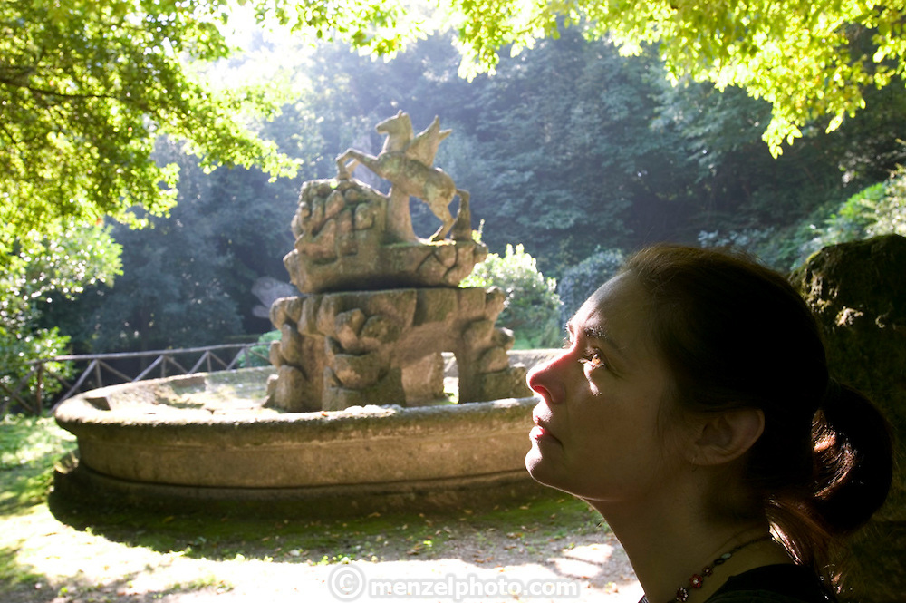 Faith D'Aluisio at the Park of the Monsters (1552). Devised by the architect Pirro Ligorio on commission of Prince Pier Franceso Orsini, called Vicino, to vent the Prince's broken heart at the death of his wife Giulia Farnese. Bomarzo, Italy. MODEL RELEASED.