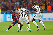 Barcelona Lionel Messi takes on Patrice Evra of Juventus and Paul Pogba of Juventus during the Champions League Final between Juventus FC and FC Barcelona at the Olympiastadion, Berlin, Germany on 6 June 2015. Photo by Phil Duncan.