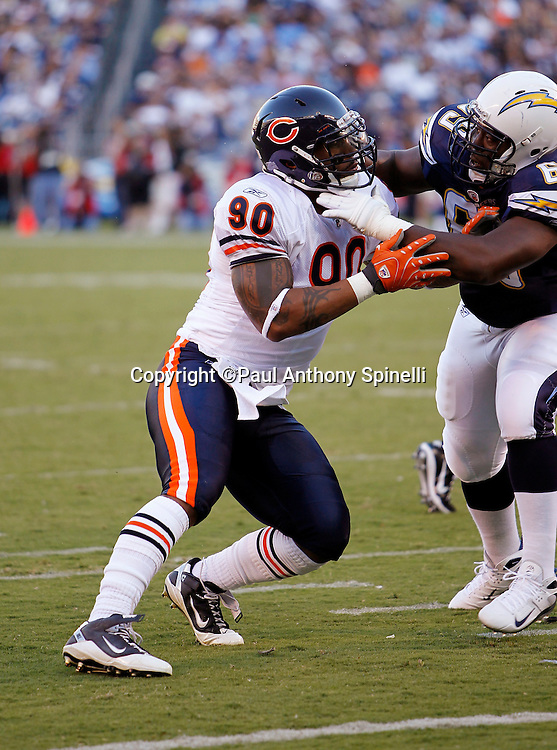 Chicago Bears defensive end Julius Peppers (90) works his way around a block during a NFL week 1 preseason football game against the San Diego Chargers, Saturday, August 14, 2010 in San Diego, California. The Chargers won the game 25-10. (©Paul Anthony Spinelli)